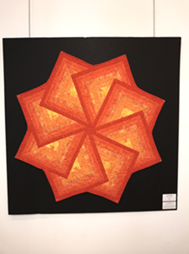Picture of Orange North Star Quilt